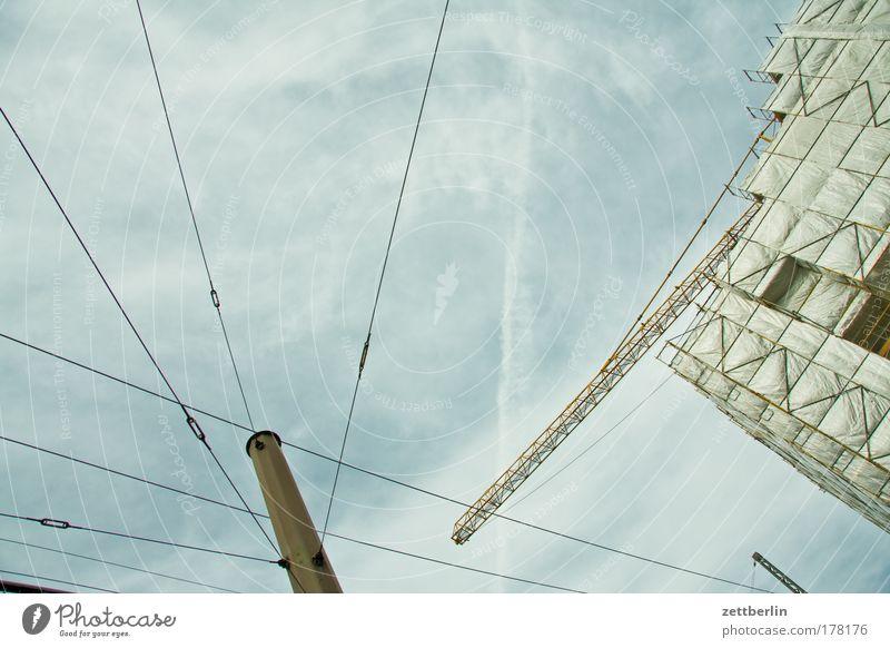 Sky Clouds Facade Construction site Electricity pylon Transmission lines Flagpole Telegraph pole Scaffold Scaffolding Covers (Construction) Cloud cover Telecommunications Overhead line Armour Construction crane