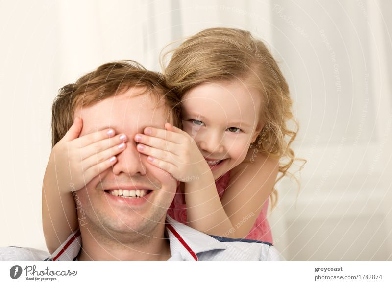 Father and daughter playing at home. Little girl closing dads eyes with hands and laughing. Family fun together Joy Happy Playing Child Human being Girl