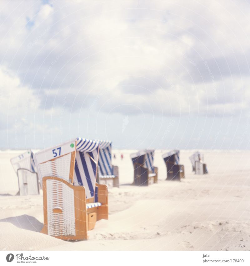 beach chair whispering Colour photo Exterior shot Copy Space top Day Light Landscape Sky Clouds Beautiful weather Beach North Sea Ocean To enjoy Bright Blue