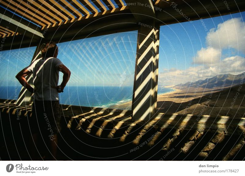 Human being Blue Summer Beach Clouds Adults Window Mountain Building Horizon Room Concrete Observe 18 - 30 years Beautiful weather Light