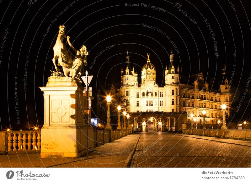 At night in Schwerin Sculpture Town Capital city Downtown Old town Deserted Castle Manmade structures Architecture State parliament Facade Tourist Attraction