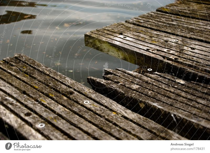 put holes in the way Colour photo Subdued colour Exterior shot Detail Deserted Day Water Lanes & trails Plank Wooden board Joist Harbour Footbridge Screw Line