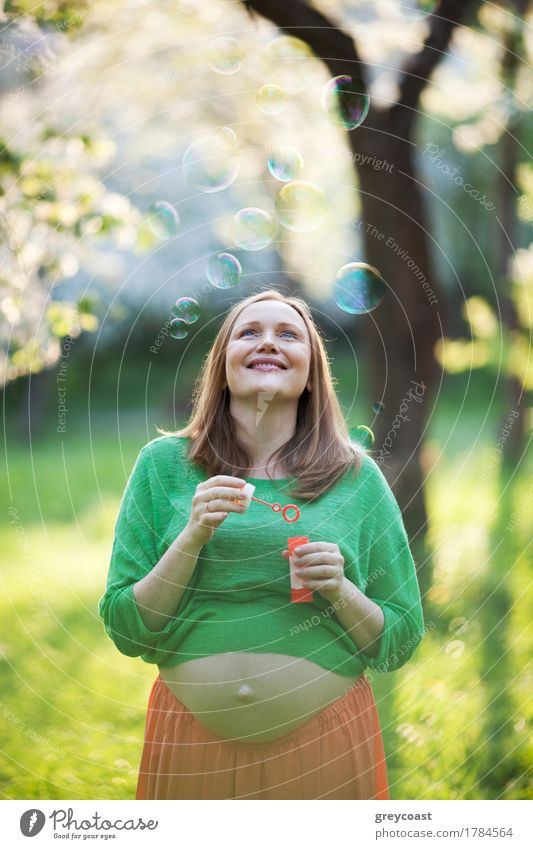 Happy pregnant woman and bubbles outdoor Human being Woman Nature Summer Green Relaxation Joy Girl Adults Family & Relations Park Leisure and hobbies Blonde