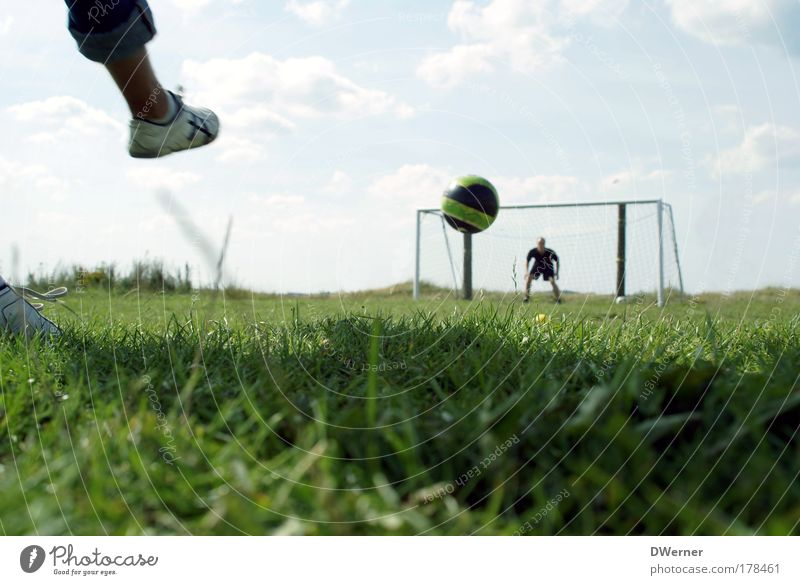 Human being Joy Soccer player Meadow Sports Playing Grass Legs Feet Footwear Leisure and hobbies Masculine Speed Ball Sporting grounds