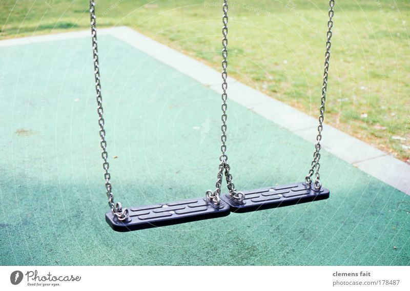 playground Colour photo Exterior shot Deserted Copy Space top Morning Light Shallow depth of field Playground To swing Green Black Calm Infancy Swing Lawn Chain