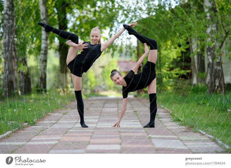 Young gymnast girls posing outdoor Happy Body Summer Sports Child Human being Girl 2 13 - 18 years Youth (Young adults) Nature Tree Lanes & trails Brunette