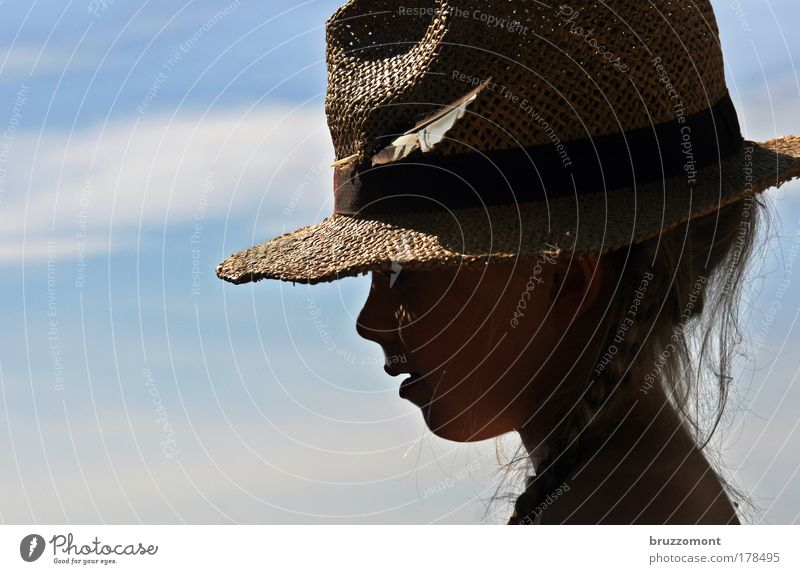 Feather in my hat Colour photo Exterior shot Copy Space left Day Shadow Back-light Downward Looking away Human being Child Girl Infancy Head Hair and hairstyles
