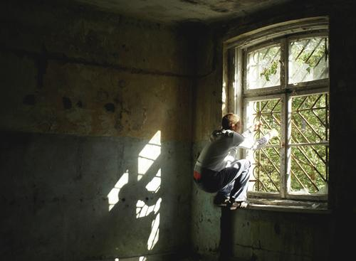 behind bars Human being Young man Youth (Young adults) 1 18 - 30 years Adults Ruin Window Stone Fight Jump Romp Dark Creepy Curiosity Strong Crazy Emotions
