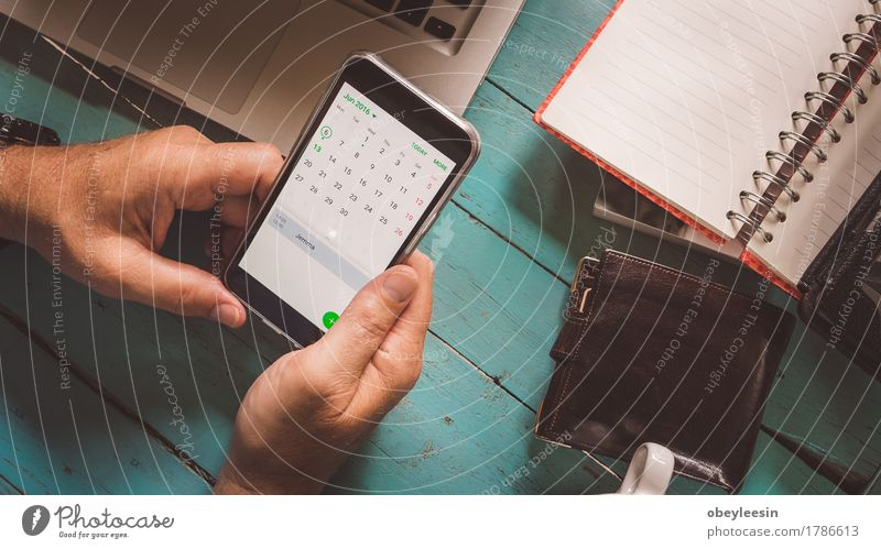 checking phone calender Lifestyle Profession Office Telecommunications Company To talk Cellphone Human being Senior citizen Hand 1 60 years and older Internet