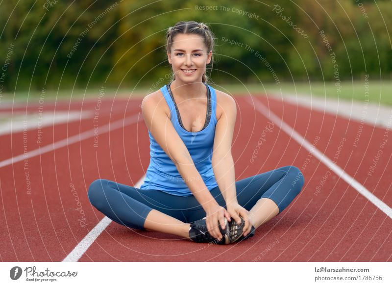 Happy fit young woman doing stretching exercises Human being Woman Youth (Young adults) Summer Beautiful 18 - 30 years Face Adults Lifestyle Sports Happy Copy Space Action Blonde Smiling Fitness