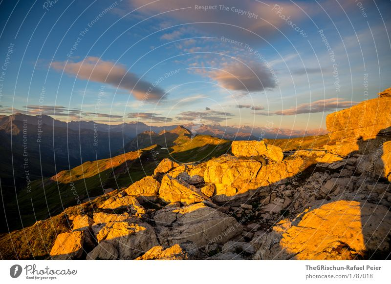 gold Environment Nature Landscape Blue Brown Yellow Gold Gray Cute Illuminate Sunrise Clouds Mountain Stone Rock Colour photo Exterior shot Deserted