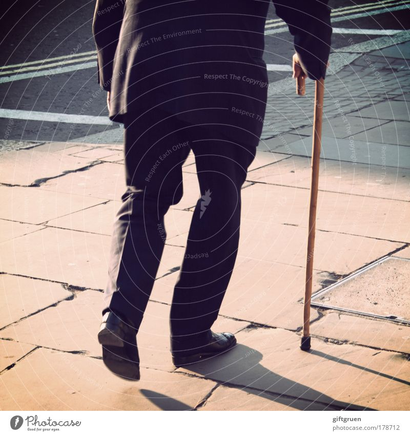 Human being Man Old Hand Adults Street Life Senior citizen Legs Feet Footwear Going Masculine To go for a walk Forwards Pants