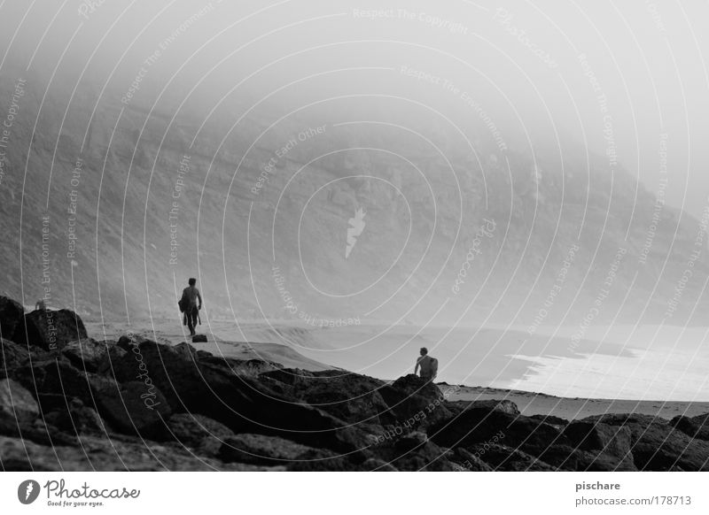 Ocean Beach Loneliness Far-off places Dark Coast Rock Fog Retro Black & white photo Mysterious Surfing Surfer Cliff Portugal