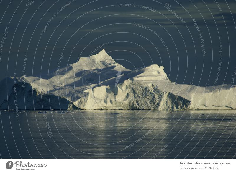 Iceberg in the midnight sun Colour photo Exterior shot Deserted Twilight Light Shadow Environment Nature Landscape Water Sun Climate change Beautiful weather
