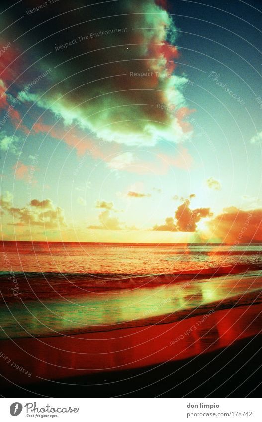 Water Sky Ocean Blue Red Summer Beach Clouds Far-off places Waves Environment Horizon Sunrise Analog Sunset Surrealism