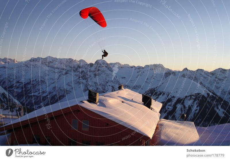 On the Top Colour photo Exterior shot Twilight Sunrise Sunset Full-length Life 1 Human being Landscape Cloudless sky Winter Alps Mountain Hut Roof Parachute