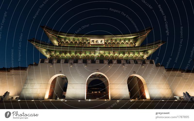 Low angle shot of the illuminated three-portal Gwanghwamun Gate at night. Landmarks of Seoul, South Korea Vacation & Travel Tourism Sightseeing Town