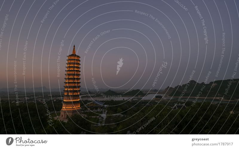 Dinh Pagoda complex in late evening with illuminated high tower temple. Sightseeing of Vietnam Vacation & Travel Tourism Culture Building Architecture Beautiful