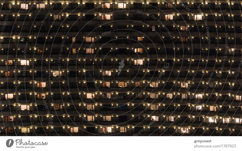 Facade of highrise apartment block with balconies. Electric lights in some windows. Housing in Bangkok, Thailand Flat (apartment) House (Residential Structure)