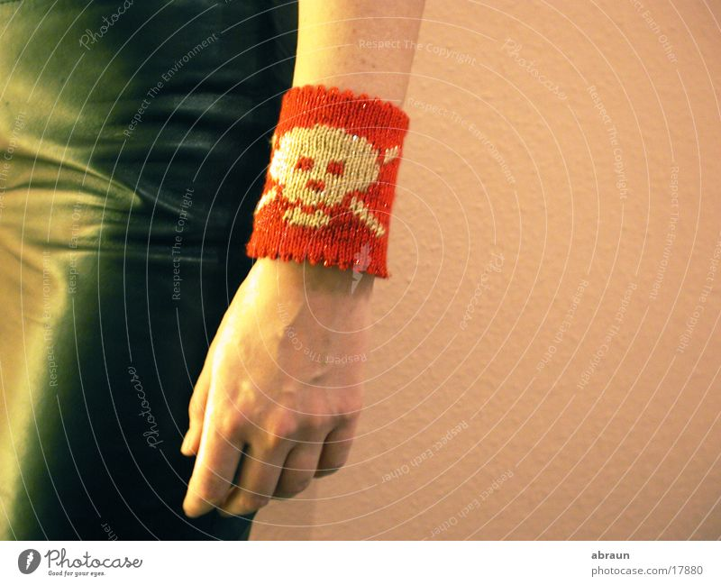 bracelet with skull Red Pink Obscure Death's head sweatband Arm Close-up