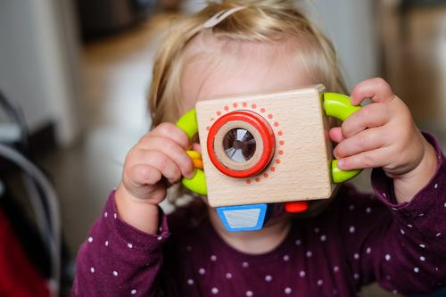 Girl with toy camera Camera Feminine Child 1 Human being 1 - 3 years Toddler Observe Wait Blonde Cool (slang) Simple Fresh Funny Brown Anticipation Enthusiasm