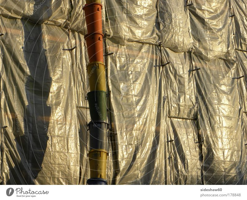 Calm Colour Wait Glittering Gold Facade Construction site Illuminate Plastic Hang Rainbow Stagnating Reflection Closing time