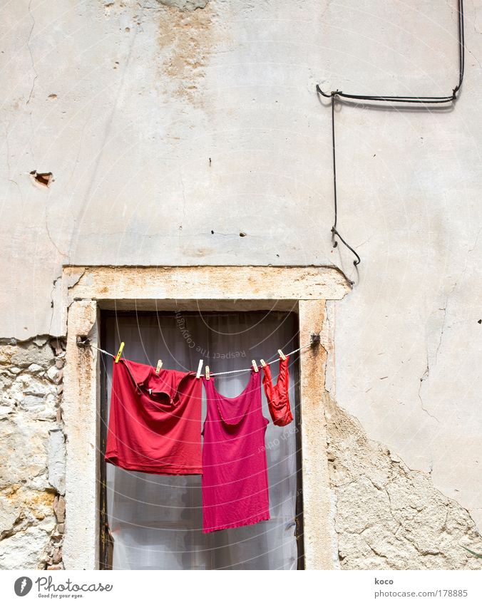 red.red.red! Colour photo Exterior shot Deserted Copy Space top Day Deep depth of field Long shot Summer Old town Window Clothing T-shirt Underwear Hang Red