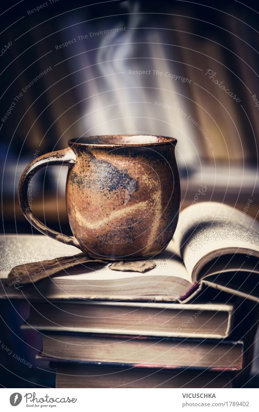 Cup with hot drink on books pile Beverage Hot drink Hot Chocolate Coffee Tea Lifestyle Style Design Living or residing Table Education Study Retro Vintage Book