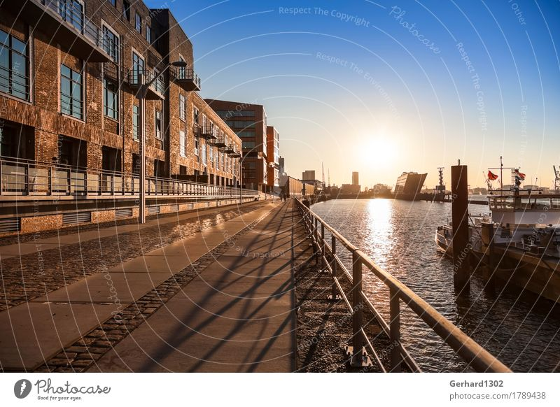 Port of Hamburg and Dockland in the backlight of the morning sun Tourism House (Residential Structure) River bank Capital city Port City Harbour Architecture