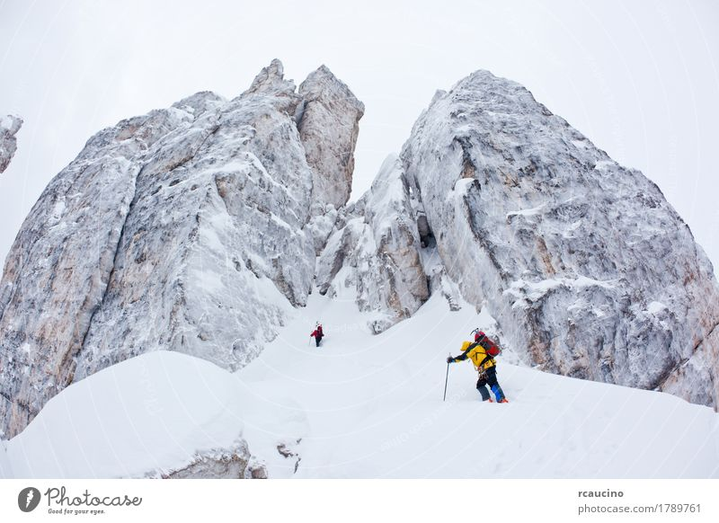 Two climbers next to the Cinque Torri, Dolomiti, Italy. Nature Landscape Winter Mountain Yellow Sports Snow Europe Dangerous Adventure Peak Climbing