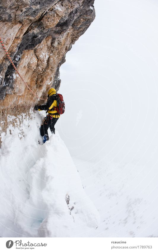 A dengerous pitch during an extreme winter climbing Nature Landscape Winter Mountain Face Yellow Sports Snow Rock Europe Dangerous Italy Adventure Rope Peak