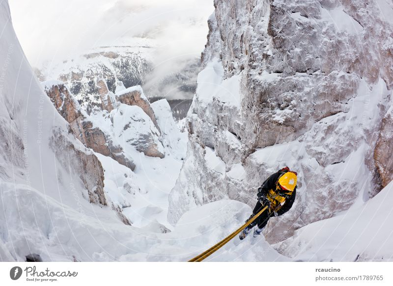 Climber abseiling back down during an extreme winter climbing Nature Landscape Winter Mountain Yellow Sports Snow Europe Dangerous Italy Adventure Rope Peak