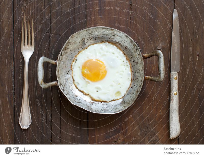 Fried egg in a old frying pan Eating Breakfast Pan Fresh White Cholesterol Eggshell Farm Frying fried egg Meal Protein Rustic Unhealthy Multicoloured Morning