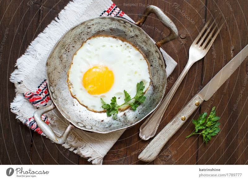 Fried egg with herbs Vegetable Eating Breakfast Dinner Pan Table Fresh Green Red White Cholesterol Eggshell Frying Meal Protein Rustic Unhealthy Parsley