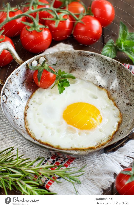 Fried egg with tomatoes and herbs Vegetable Eating Breakfast Dinner Pan Table Wood Fresh Yellow Green Red Cholesterol Frying Meal Protein Rustic Unhealthy