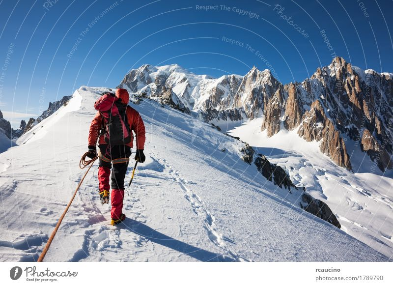Mountaneer climbs a snowy ridge in Mont Blanc, France Adventure Expedition Sun Winter Snow Mountain Sports Climbing Mountaineering Success Man Adults Nature