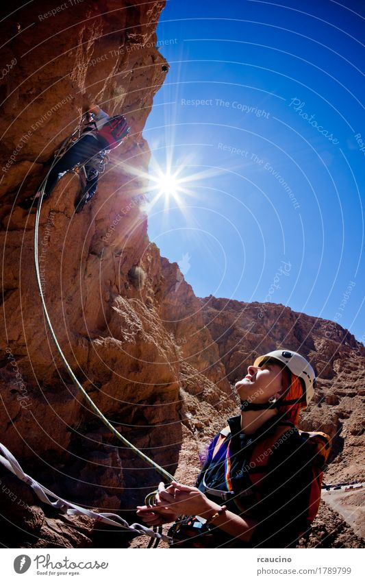 A female climber belays during a climbing in Morocco Face Vacation & Travel Adventure Expedition Summer Sun Mountain Sports Climbing Mountaineering Rope Girl