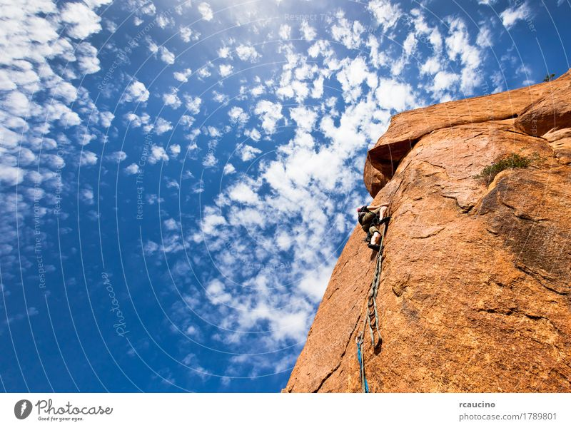climber on a steep granitic cliff, Morocco, Africa. Vacation & Travel Adventure Expedition Mountain Climbing Mountaineering Rope Man Adults Landscape Clouds