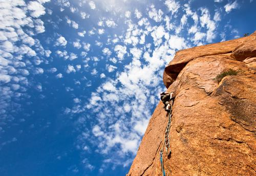 climber on a steep granitic cliff, Morocco, Africa. Vacation & Travel Man Blue Landscape Clouds Mountain Adults Adventure Rope Climbing Effort Mountaineering