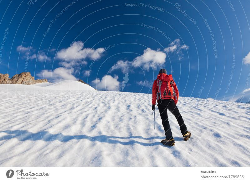 Mountaineer walking uphill on a glacier. Mont Blanc, France. Human being Sky Man Blue White Landscape Red Loneliness Clouds Winter Mountain Adults Snow Boy (child) Europe Italy