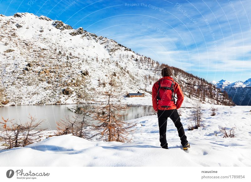 Hiker Winter Mountain Lake Human being Sky Nature Vacation & Travel Man White Tree Landscape Red Relaxation Loneliness Black Adults Sports