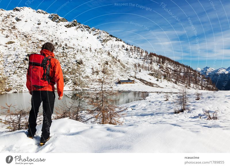 Hiker Winter Mountain Lake Relaxation Vacation & Travel Tourism Adventure Expedition Snow Sports Human being Boy (child) Man Adults Nature Landscape Sky Tree