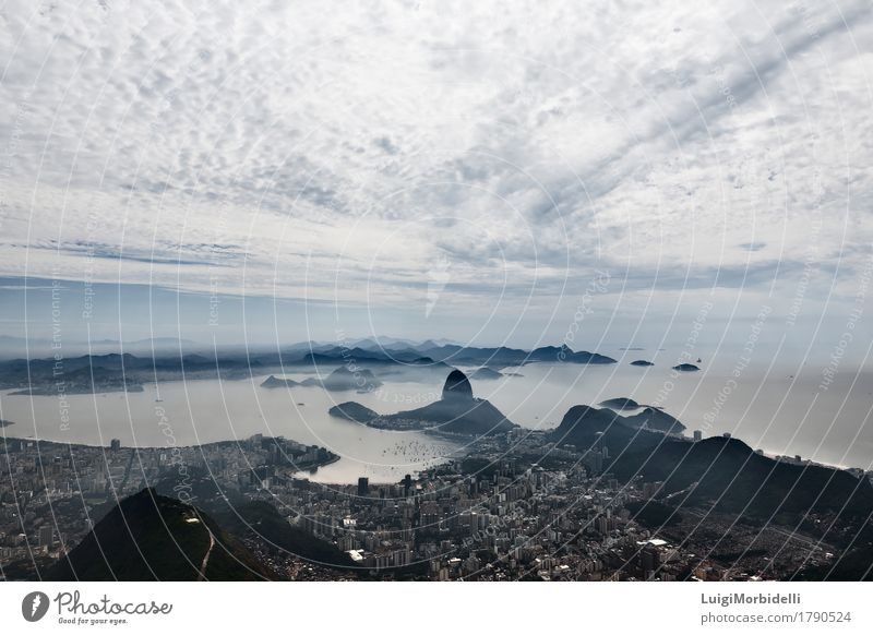 A beautiful panorama of the sugarloaf mountain and clouds Nature Vacation & Travel Colour Landscape Ocean Clouds Mountain Coast Tourism Fog Trip Vantage point Haze Tourist Horizontal Brazil