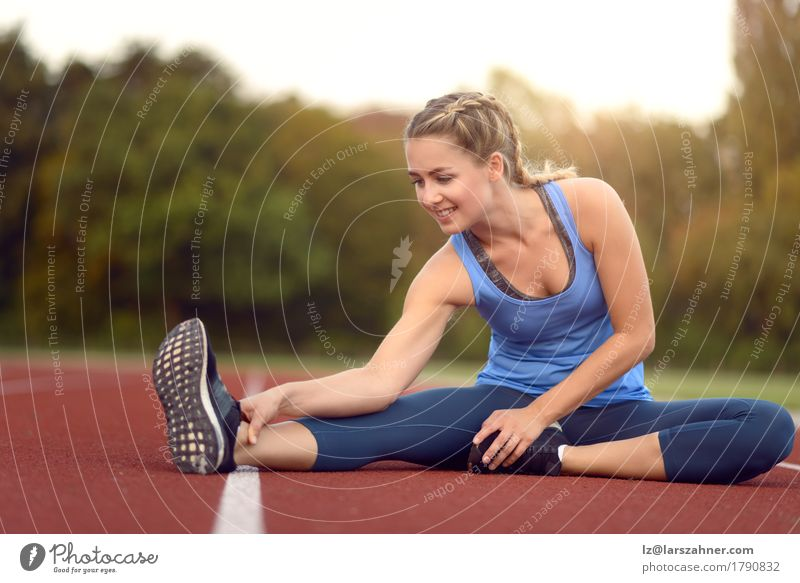 Happy fit young woman doing stretching exercises Human being Woman Youth (Young adults) Summer Beautiful 18 - 30 years Face Adults Lifestyle Sports Feminine Happy Copy Space Action Blonde Smiling