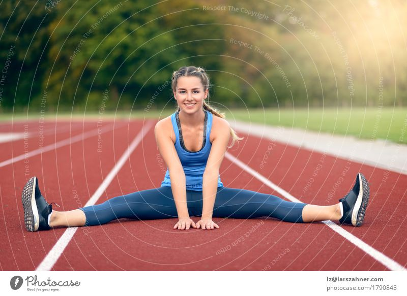 Happy fit young woman doing stretching exercises Lifestyle Beautiful Face Summer Sports Feminine Woman Adults 1 Human being 18 - 30 years Youth (Young adults)