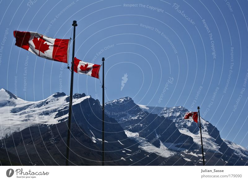 Canada Colour photo Exterior shot Nature Landscape Adventure Flag Mountain Snow Sky Blue
