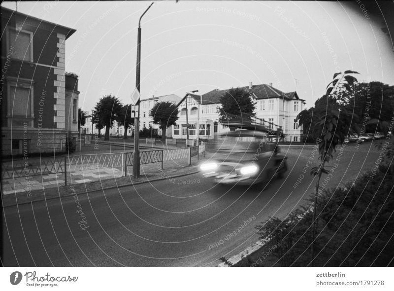 Kühlungsborn, 1985 Street Transport Car Blur Speed Haste barkas Evening Twilight Deserted Gloomy Crossroads Road junction Town Small Town Black & white photo