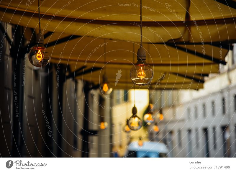 street café Town Port City Old town Pedestrian precinct Illuminate Electric bulb Suspended Lighting Moody Lamp Lamplight Sidewalk café Café Restaurant Summer