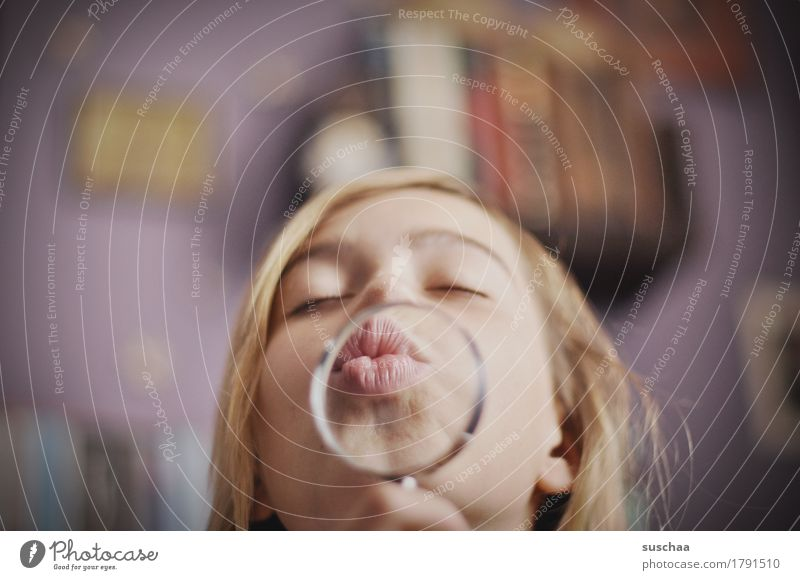 child with magnifying glass and kissing mouth Girl Woman Youth (Young adults) Young woman Face Lips Magnifying glass Enlarged Passion Kissing Lens Child Infancy