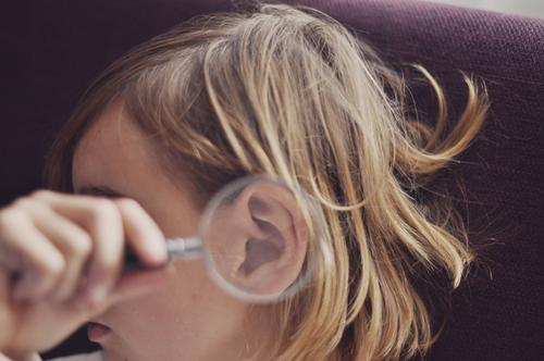 hear better | youth with a magnifying glass on your ear Head Human being Child girl Youth (Young adults) Young woman by hand Magnifying glass Ear Enlarged